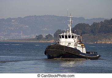 A tugboat chugs along in San Francisco bay.