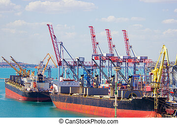 Tugboat assisting container cargo ship to harbor quayside...