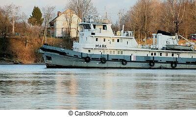 Tugboat - caravan towed by ships