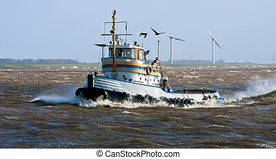 Tugboat crossing the storm at his way to the safe harbor