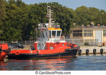 Tugboat moored on the wharf in the Port of Gdansk, Poland.