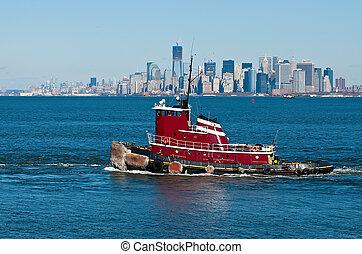Tugboat on the Hudson River against the backdrop of Manhattan