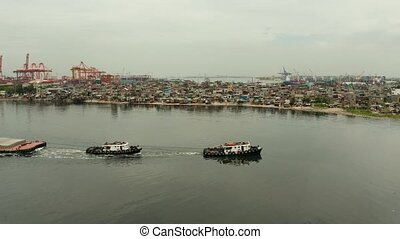 Tugboat pulling heavy loaded barge. - Tugs pulling heavy...