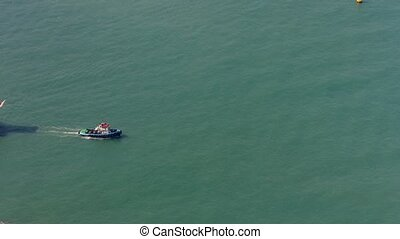 "Tugboat Towing a Barge off Hong Kong. Video - ""Tugboat..."