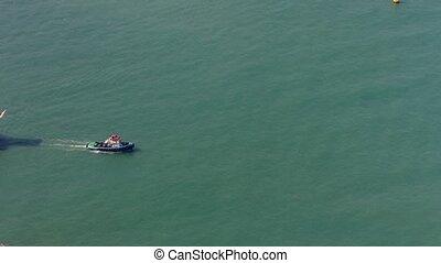 "Tugboat Towing a Barge off Hong Kong. Video - ""Tugboat..."