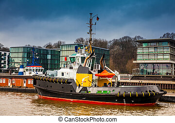 Tugboats docked at the Hamburg port on the banks of the Elbe...