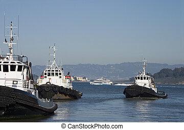 Tugboats - A group of tugboats chug along in San Francisco...