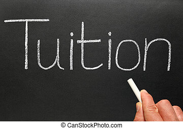 Tuition, written on a blackboard.