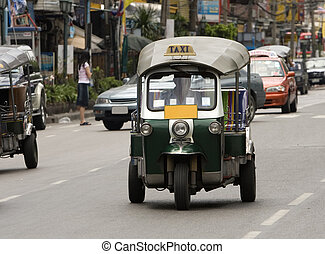 Tuk-tuk (cab) speeding on the street. Picture taken in...