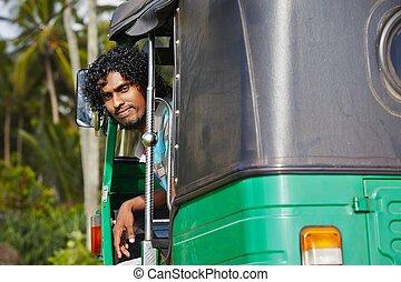 Tuk-tuk driver - Young tuk-tuk driver in Sri Lanka.