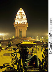 Tuk-tuk drivers and monument- Phnom Penh, Cambodia