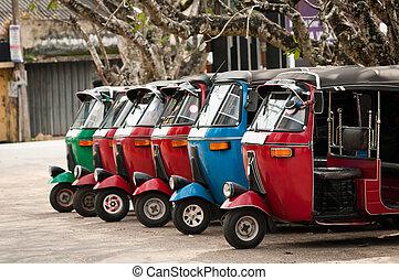 Tuk-tuk is a popular asian transport as a taxi. - Tuk-tuk is...