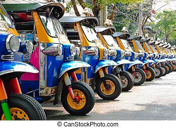 Tuk tuks taxi lined up in Bangkok, Thailand