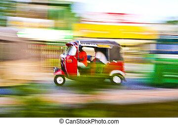 Tuktuk is racing along the streets