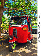 Tuktuk taxi on the road of Sri Lanka, Ceylon travel car