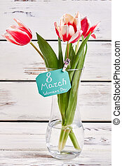 Tulip flowers on wooden background.