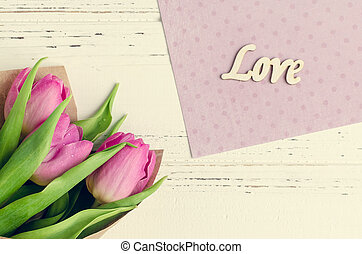 Tulip flowers with wooden word LOVE