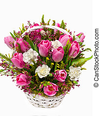 tulips and carnations in a basket