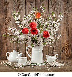 Tulips and cherry blossom on a decorated table