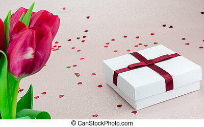 tulips and gift box on pink background