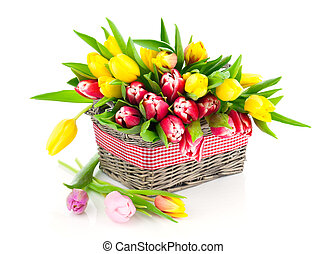 tulips in a basket on a white background