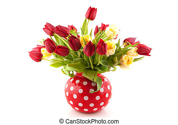 cheerful bouquet of red and white tulips in dotted vase