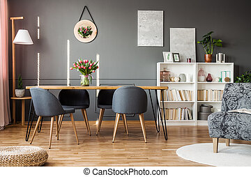 Tulips in grey dining room - Grey chairs at wooden table...
