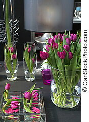 tulips in interior in glass as decoration