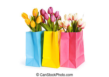 Tulips in shopping bag isolated on white