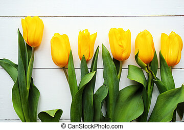 Tulips on white wooden table. Top view with copy space