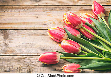 Tulips on wooden background, copy space