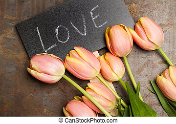 Tulips with a sign with the word love