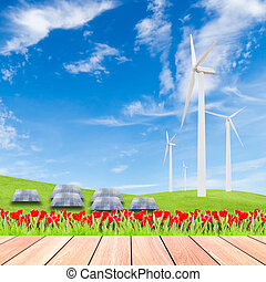 tulips with wind turbine and solar panels on green grass field a