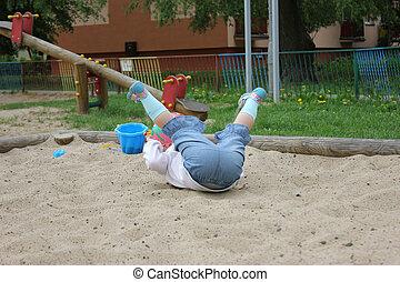 tumble - Child falls playing in sandbox