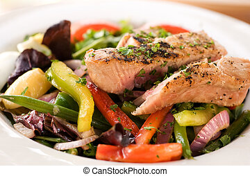 Grilled tuna steak with vegetables and salad. Shallow DOF