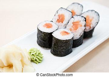 Tuna maki on a plate - Tuna maki with wasabi and ginger on a...