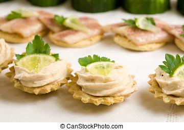 Tuna salad on toast - Small toast filled with tuna salad and...