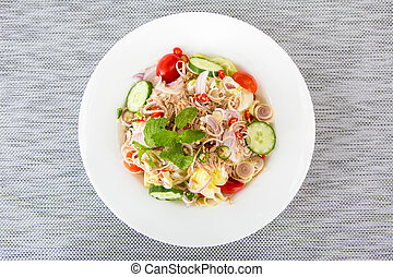 Tuna salad with fresh vegetable on white plate.