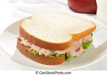 Tuna sandwich with an apple and milk - A tuna sandwich with...