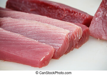 tuna sliced - cuted tuna on a white table