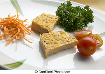 Tuna with salad in a white dish