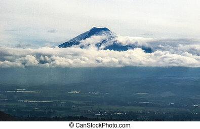 Tungurahua Volcano  with misty Valley of Latacunga, Ecuador