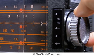 Tuning Analog Radio Dial Frequency on Scale of the Vintage Receiver