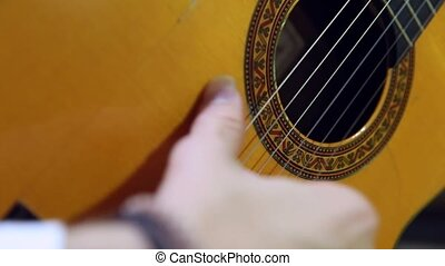 Tuning and playing a classical spanish acoustic guitar -...