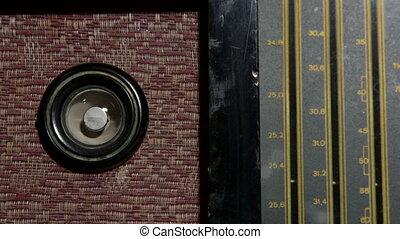 Tuning station on vintage radio