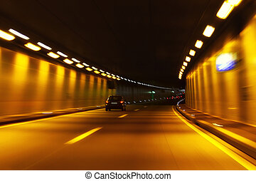 tunnel in motion - Car trails in motion through a tunnel
