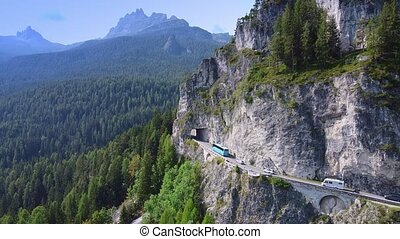 Aerial drone flight of an asphalt road in the Dolomites mountains in Italy