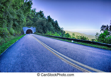tunnel through mountains on blue ridge parkway in the morning