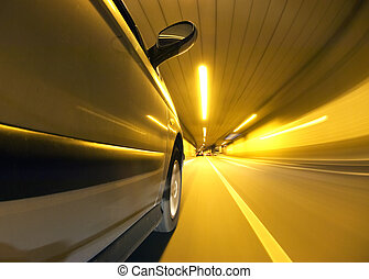 Tunnel Vision - A car driving inside a tunnel in the left...