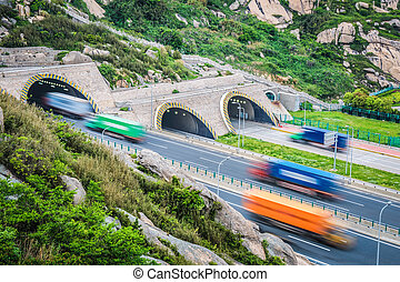 tunnel with container trucks - container trucks motion blur...